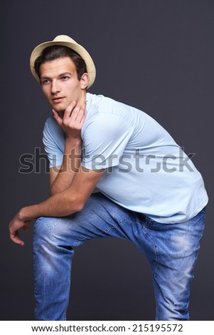 Thinking man leaning on his knee - stock photo