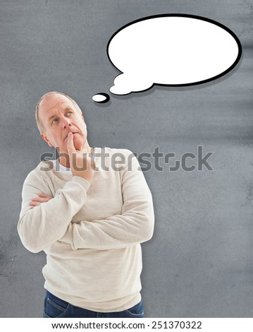 Thinking mature man with hand on chin against grey - stock photo