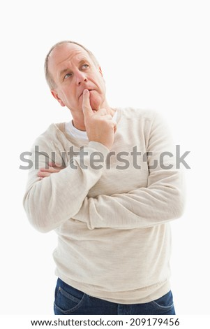 Thinking mature man with hand on chin on white background