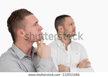 Thinking men against a white background