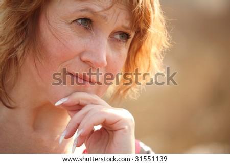 Thinking middleaged woman - stock photo