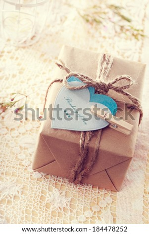 Thinking of you message written on heart-shaped tags and hand crafted present box  - stock photo