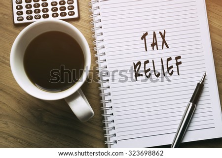 Thinking on Tax Relief, personal finance conceptual - stock photo