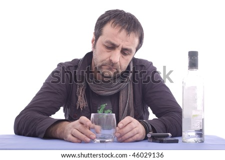 Thinking sad man sitting at the table isolated over white background - stock photo