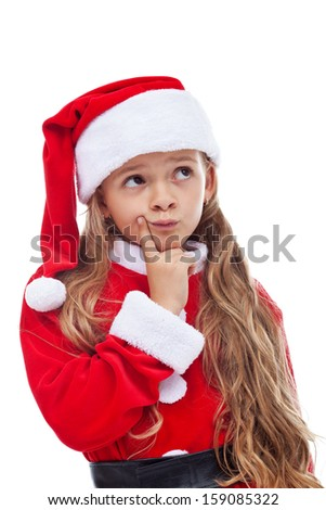 Thinking Santa - little girl in seasonal outfit in a thoughtful pose, isolated