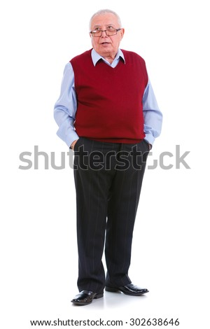 Thinking senior old teacher man with glasses, holds hands in pockets, cardigan marsala color and shirt, isolated on white background. Human emotions, facial expressions. Education concept