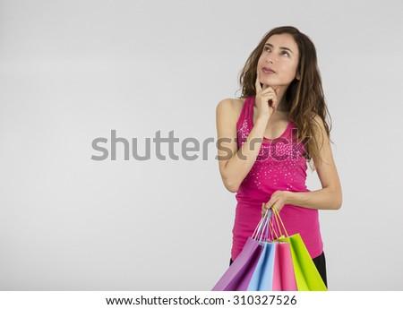 Thinking shopping woman - stock photo
