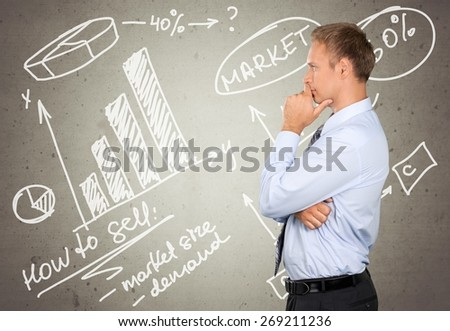 Thinking. Side profile of a young businessman contemplating - stock photo