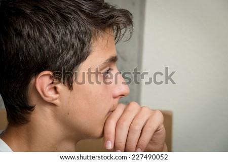 Thinking teenager - stock photo