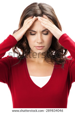 Thinking, tired or ill with headache young brunette woman, isolated on white background - stock photo