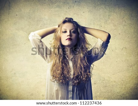 Thinking woman behind a wall - stock photo