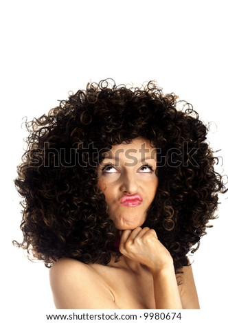 thinking woman - face expression.  Woman wearing a huge afro wig. Model in a big afro wig - stock photo