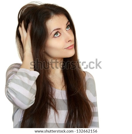 Thinking woman holding hair and looking up. Closeup portrait isolated on white background - stock photo