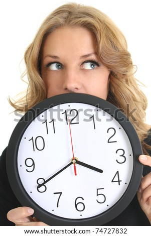 Thinking woman in black with clock over white - stock photo
