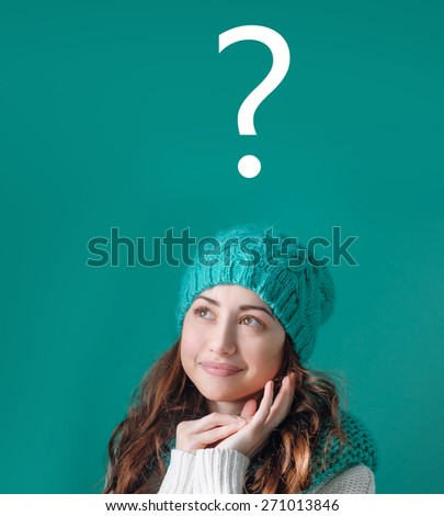 thinking women in turquoise knitted hat with question. - stock photo