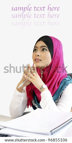 Thinking young business woman day dreaming looking up - stock photo