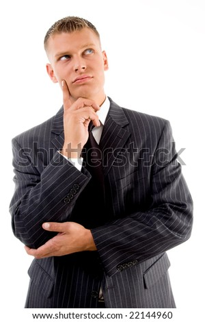 thinking young businessman looking upward on an isolated background - stock photo