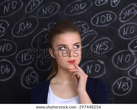 Thinking young woman with yes or no choice on grey background. - stock photo