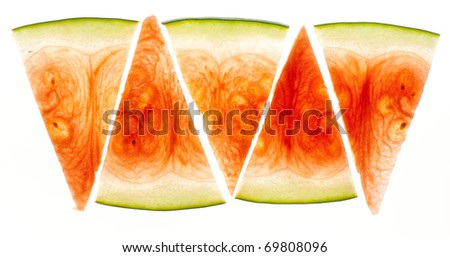 Thinly slices watermelon pieces lit from behind - stock photo