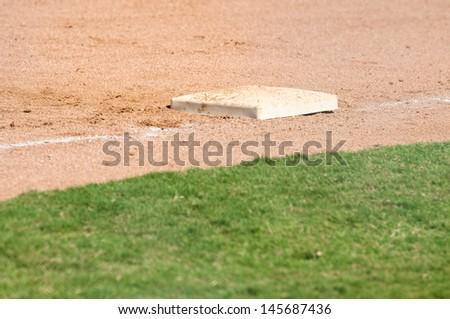 Third base on a baseball field - stock photo