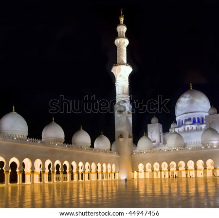 Third biggest moque in the world, located in Abu Dhabi, which is named Grand Mosque or Shiekh Zayed Mosque. The mosque is illuminated in the night. - stock photo