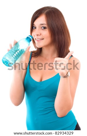Thirsty young women with water after fitness workout. Isolated on white - stock photo