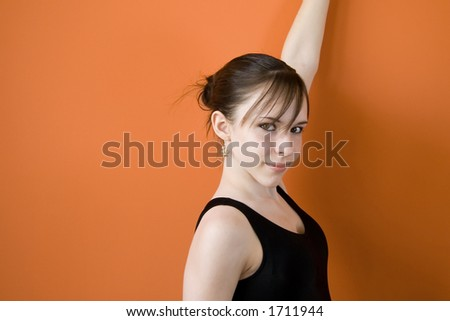 Thirteen years old teenage girl isolated on orange background - stock photo