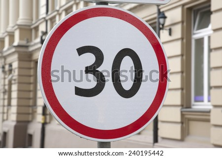 Thirty Kilometer Per Hour Speed Limit Sign in Urban Setting - stock photo