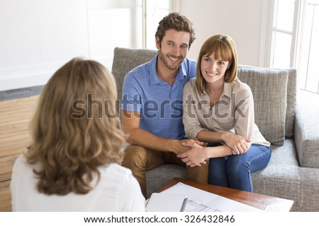 Thirty year old couple meeting financial adviser for investment - stock photo