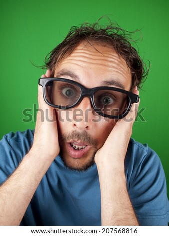 Thirty year old man with 3d glasses watching a movie over a green background - stock photo