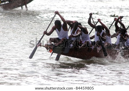 THIRUVALLA, INDIA - SEPT 09 : Oarsmen of a snake boat team row aggressively in the Pumba Boat race on September 09, 2011 in Thiruvalla, Kerala, India. - stock photo