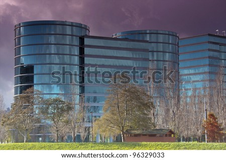 this a photo of round glass buildings blue in color - stock photo