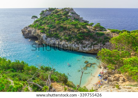 This amazing beach is located in Santanyi (Majorca) and it had super clean and clear water - stock photo