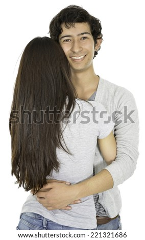 This boy is hagging his girlfriend and give us his back - stock photo