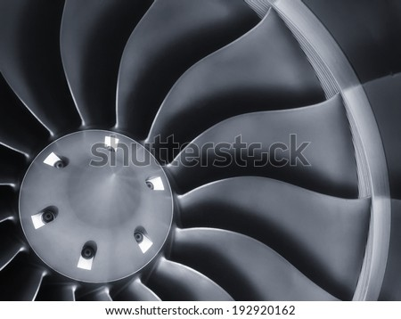 This close up image of a business aircraft jet engine inlet fan makes a great business travel or aerospace background. - stock photo