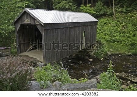 This covered bridge, built in 1879, has a maximum load of 10 adults. - stock photo