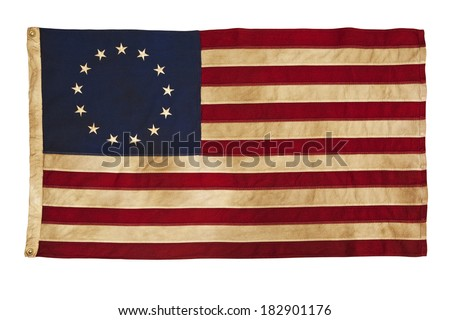 This design for the American flag, popularly attributed to Betsy Ross, was designed during the American Revolutionary War features 13 stars to represent the original 13 colonies.  - stock photo