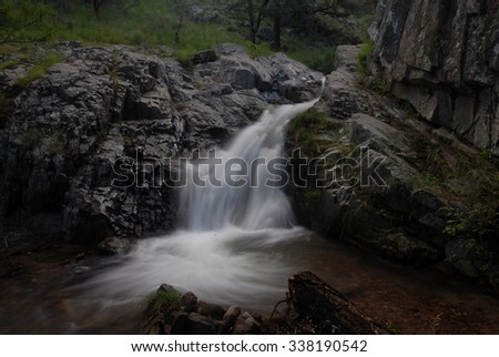 This fast moving waterfall was photographed in SE Arizona during the monsoon season. - stock photo