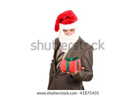 This gift for you. Businessman in suit with santa hat on head. Isolated over white background - stock photo