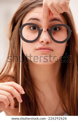 this girl jokes with black fake carton glasses - stock photo