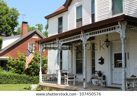 This home town neighborhood hold tons of charm, especially when you throw in turn of the century real estate and an fashioned front porch. - stock photo
