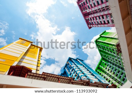 This image shows a colurful High Density Housing Block in Singapore - stock photo