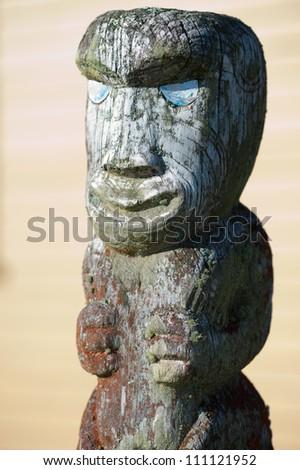 This image shows a Maori carving - Rotorua, New Zealand - stock photo