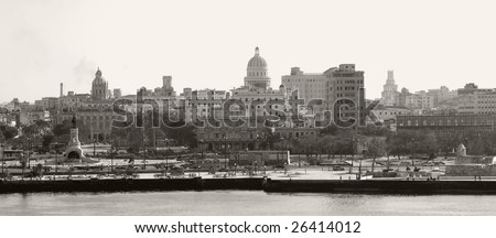 This image shows a panoramic sepia toned image of Havana's skyline. - stock photo