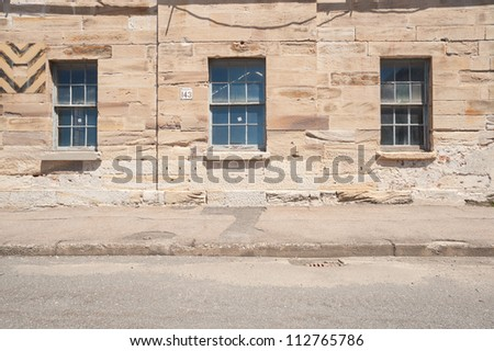 This image shows an old sandstone wall on  Cockatoo Island,  Sydney, Australia. - stock photo