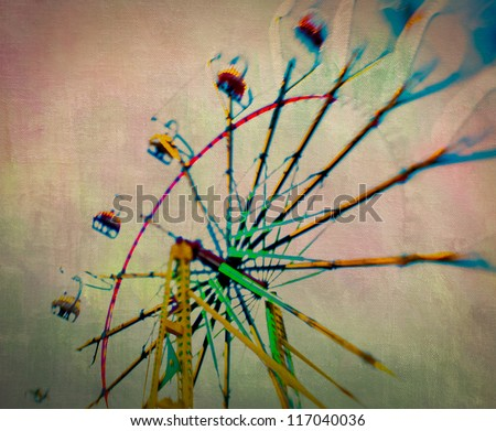 This image was taken with a lensbaby lens which is a creative lens system that emphasizes selective focus, texture was added in order to create a more carnival feel - stock photo