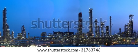 This is a big oil-works in night ligths. - stock photo