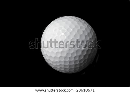 This is a black and white image of an isolated golf ball - stock photo