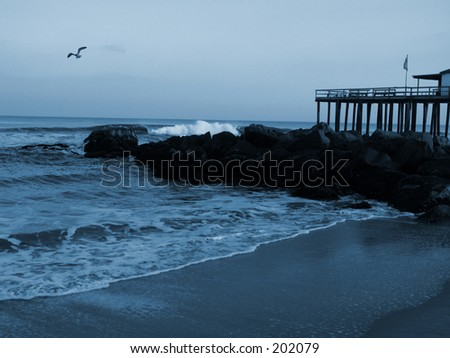 This is a blue duo-tone of the surf at Ocean Grove Beach in New Jersey. - stock photo