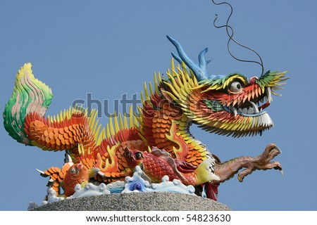 This is a colorful Chinese Dragon.  It was at a scenic spot, overlooking the sea.  Dragons are very symbolic in Chinese Culture. - stock photo